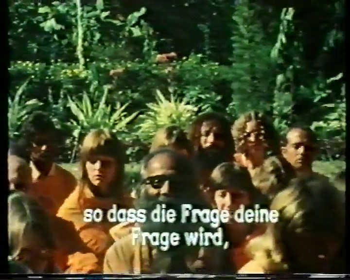 File:Bhagwan (1978) ; 44min 50sec --Swami Anand Maitreya-- (middle, with glasses).jpg